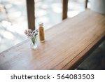 Purple Flower In Glass On Wood...