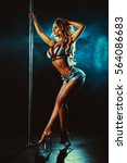 young sexy slim woman pole... | Shutterstock . vector #564086683
