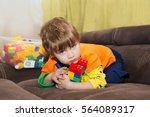 greedy boy. little boy playing... | Shutterstock . vector #564089317