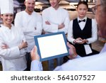 restaurant manager briefing to... | Shutterstock . vector #564107527