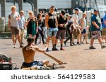 Small photo of SYDNEY, AUSTRALIA - OCTOBER 16, 2016: Aborigine man playing a didgeridoo during a music performance near Circular Quay in Sydney harbour.