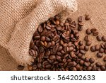 coffee beans on burlap...   Shutterstock . vector #564202633