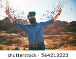 bearded guy in desert wearing... | Shutterstock . vector #564213223