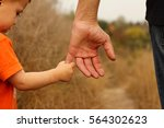 the parent holds the hand of a... | Shutterstock . vector #564302623