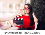surprised actress with...   Shutterstock . vector #564322093
