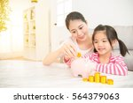 happy asian chinese mother and... | Shutterstock . vector #564379063