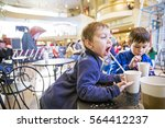 kids in a cafe drinking hot... | Shutterstock . vector #564412237