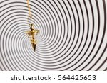 pendulum used for hypnotism and ... | Shutterstock . vector #564425653