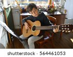 child is practicing acoustic... | Shutterstock . vector #564461053