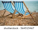 two deck chairs on a pebble... | Shutterstock . vector #564515467