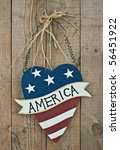 "vintage wooden patriotic heart shape decor with word ""america"" on the door - stock photo"