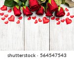 Red Roses And Greeting Card On...