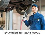 portrait of a mechanic... | Shutterstock . vector #564570937