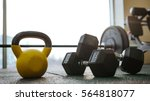 Small photo of Photo of sport equipment in gym. Dumbbells on floor.