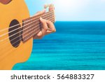 acoustic guitar player on blue... | Shutterstock . vector #564883327
