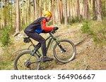 cyclist riding a mountain bike... | Shutterstock . vector #564906667