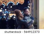 couple window shopping outdoors ... | Shutterstock . vector #564912373