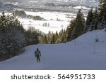 ski run in bavaria overlooking... | Shutterstock . vector #564951733