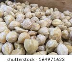 Small photo of Close up of candlenuts in a box storage. Candlenut or Aleurites moluccanus is a very healthy food known to be an organic supplement fpr various health purposes.