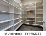 open door to empty pantry room... | Shutterstock . vector #564982153