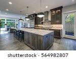 modern kitchen with brown... | Shutterstock . vector #564982807