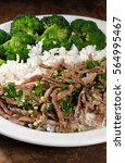 Small photo of boiled beef with pungent spokes sauce garnish rice with broccoli
