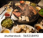 korean barbecue with side dishes | Shutterstock . vector #565218493