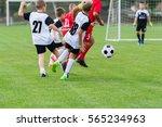 boys kicking football on the... | Shutterstock . vector #565234963