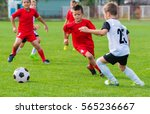 boys kicking football on the... | Shutterstock . vector #565236667