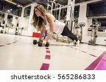 young woman doing a plank... | Shutterstock . vector #565286833