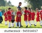 children's soccer team in the... | Shutterstock . vector #565316017