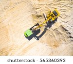 aerial view of a excavator... | Shutterstock . vector #565360393