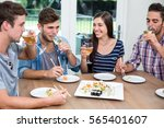 happy young friends drinking... | Shutterstock . vector #565401607