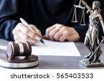 judge with wooden gavel on table | Shutterstock . vector #565403533