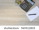 coins  calculator and some... | Shutterstock . vector #565412833