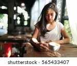 woman in coffee shop with a cup ... | Shutterstock . vector #565433407