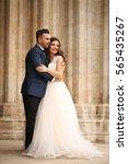 groom and bride posing in front ... | Shutterstock . vector #565435267