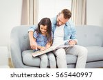 father and daughter reading... | Shutterstock . vector #565440997