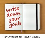 the words write down your goals ... | Shutterstock . vector #565465387