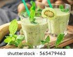 fresh homemade kiwi smoothies... | Shutterstock . vector #565479463