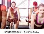 fit women working out at... | Shutterstock . vector #565485667