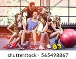 smiling fitness class posing... | Shutterstock . vector #565498867