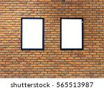 Small photo of two empty advert frames advert on brick wall