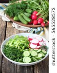 Small photo of Salad bowl contained of radish , cucumber , dill and green onion