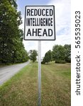 Small photo of REDUCED INTELLIGENCE AHEAD sign foreboding a bleak future. Vertical.