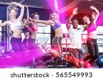 fit group smiling and jumping... | Shutterstock . vector #565549993