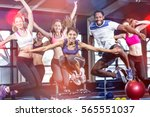 fit group smiling and jumping... | Shutterstock . vector #565551037