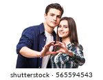 young couple make heart symbol... | Shutterstock . vector #565594543