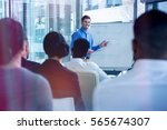 smiling businessman explaining... | Shutterstock . vector #565674307