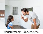 father scolding daughter at home | Shutterstock . vector #565690693